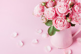 Beautiful rose flowers in pink vase for Womens day or Mothers day greeting card.