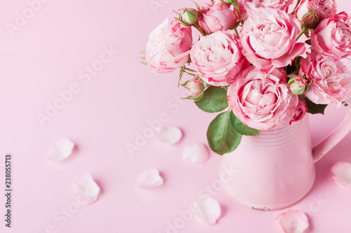Beautiful rose flowers in pink vase for Womens day or Mothers day greeting card. - 238055713