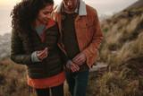 Romantic couple hiking on mountain trail