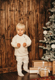 Christmas photo of small cute boy playing with toys in decorated home - 238062172