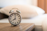 Metal Alarm clock on white bed 8 am. - 238063127