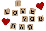 Wooden blocks spelling the inscription I love you on dad