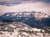 Alpine mountain range covered with snow. Winter landscape.