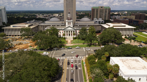 Flags Blow Atop Traffic Below The Capital Dome In Tallah Ee Florida