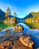 Fantastic autumn sunrise of Hintersee lake. Classic postcard view of Hintersee