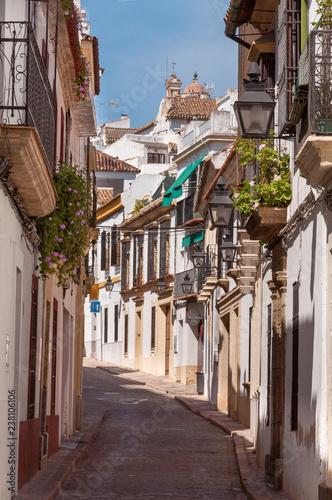 narrow street in old town córdoba, spain