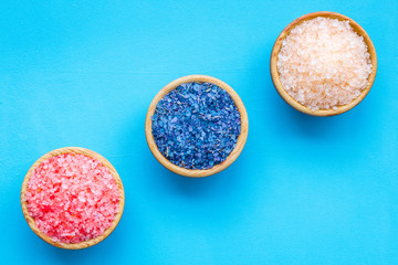 Colorful bath salt pink and blue on blue background top view copy space © 9dreamstudio