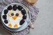 Leinwanddruck Bild - Funny kids breakfast porridge with berries