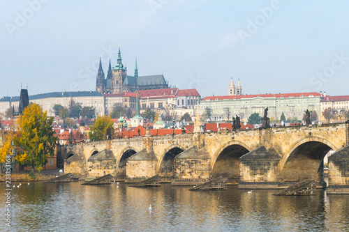 prague river bank and old town at background, czech republic