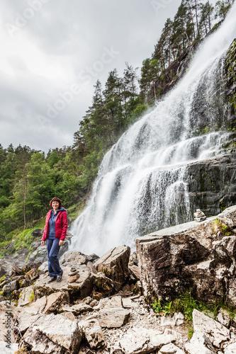 Tourist woman at waterfall Svandalsfossen, Norway - 238133579