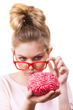 Funny silly woman holding human brain - 238133707