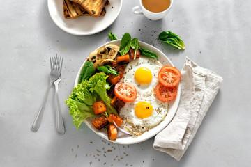 Breakfast table Breakfast plate fried eggs vegetables mushrooms toast top view healthy table