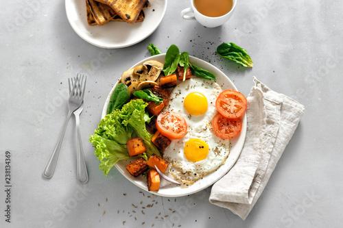 Breakfast table Breakfast plate fried eggs vegetables mushrooms toast top view healthy table - 238134369