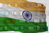 flow of cars shines through the flag of India