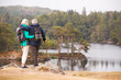 Quadro Senior couple standing embracing and admiring the view of a lake, back view