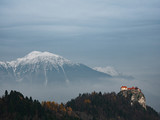 Bled Castle and high mountain at background. Bled, Slovenia.