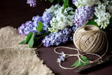 Morning. Spring season. Mood. Flowering lilac. Floristry. Collect the bouquet. - 238164914