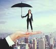 Leinwanddruck Bild - Pretty businesswoman with umbrella