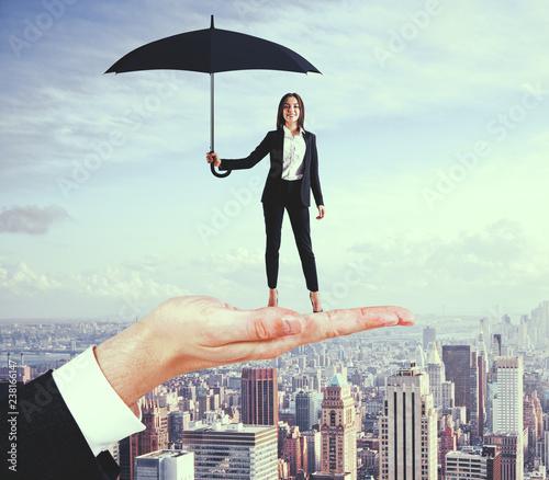 Leinwanddruck Bild Pretty businesswoman with umbrella