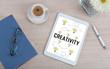 Creativity concept on a digital tablet