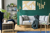Golden, green and grey accents in contemporary living room interior - 238168549