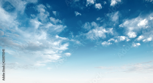 Clear blue sky and white clouds - 238170341