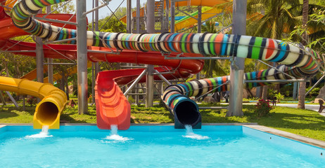 Sliders in the water park swimming pool