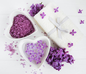Spa towel and massage products with lilac flowers © almaje