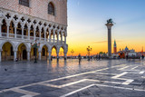 Sunrise view of piazza San Marco, Doge's Palace (Palazzo Ducale) in Venice, Italy. Architecture and landmark of Venice. Sunrise cityscape of Venice.