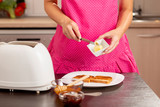 Woman taking some butter for a sandwich - 238197149