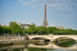 PARIS, FRANCE - MAY 26, 2018: View of the Eiffel Tower and the Invalides Bridge. Embankment of the Seine.