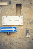 Street plate with the text Corso Italia on a wall