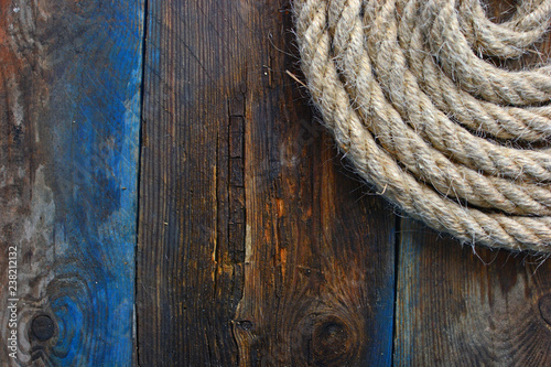Nautical background for your design. Nautical rope on old wooden deck.