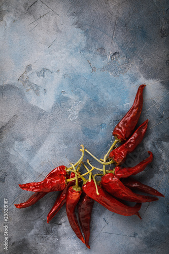 Bunch of dry red peppers on a table with copy space - 238215187