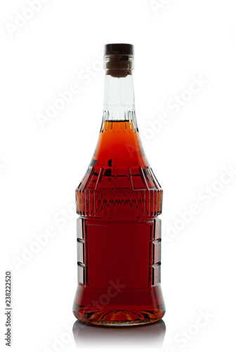 Bottle of cognac on white background