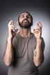 portrait of caucasian man crossing finger