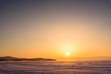sunset sun in the vast expanses of Lake Baikal on Olkhon Island © Aleksey
