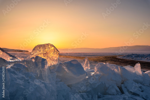 sunset sun in the vast expanses of Lake Baikal on Olkhon Island, through the transparent ice