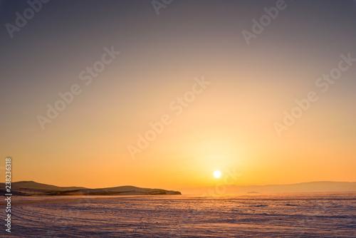 sunset sun in the vast expanses of Lake Baikal on Olkhon Island