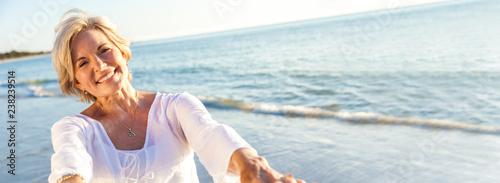 Leinwandbild Motiv Happy Senior Woman Dancing Tropical Beach Panorama