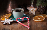 Coffee in a cup with gingerbread  and candy