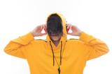 young teen with hood and isolated earphones