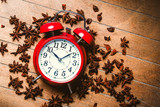 Vintage alarm clock and star anise on wooden background - 238252573