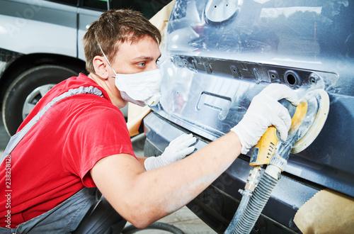 auto repairman grinding autobody - 238258128
