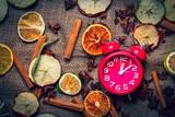 Alarm clock and Chrsitmas tea ingredients on jute background - 238270391