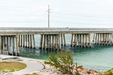 Seven Mile Bridge landscape of Florida Keys water atlantic ocean, beach on Overseas Highway, car on road