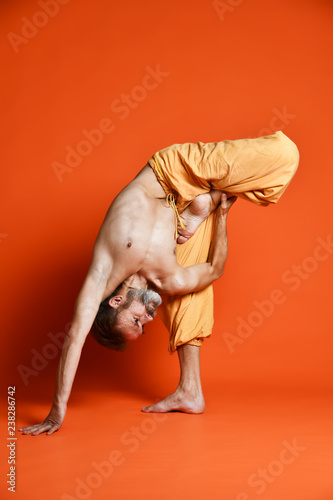 Plakat Man practicing advanced yoga. A series of yoga poses.