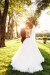 Leinwanddruck Bild - portrait of the bride and groom in nature, beautiful couple in love