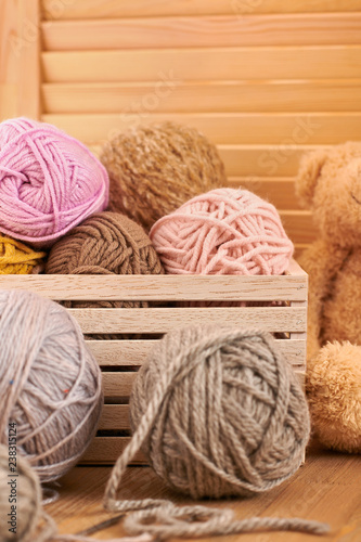 Woolen yarn and fabric on the window sill. - 238315124
