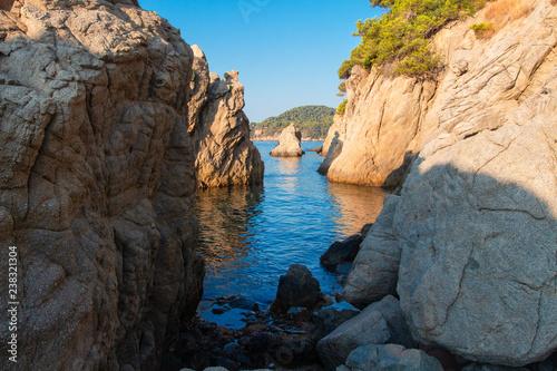 Bay in mediterranean, Spain. Cliff on sea beach in Lloret de Mar